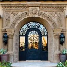 luxury front doorsOrnate wrought iron and carved stone Mediterranean front entrance