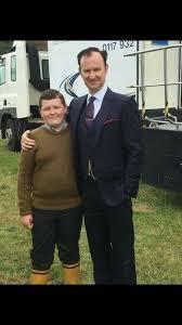 Two Mycroft's. Mark Gatiss with Aaron Richards behind the scones. Series 4.    Sherlock actor, Sherlock holmes bbc, Mycroft holmes