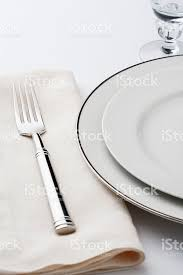 fine dining plate setting. fine dining table setting place china plate silverware napkin royalty-free stock photo u