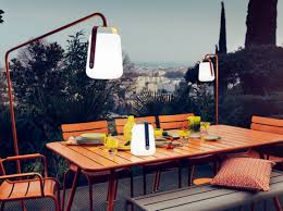 outdoor table lighting ideas. Fermob Balad Outdoor Lanterns Hanging From Metal Frames Over Orange Table On Terrace Lighting Ideas T