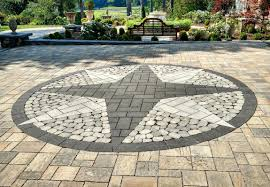 paver patio with ornate inlay and border designs
