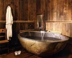 rustic stone bathroom designs. rustic bathroom with stone bathtub designs