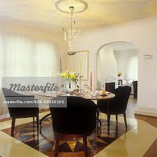 artsy crystal chandelier crystal on table sheer ds white walls arched doorway with partial twisted columns faux painted ceiling of clouds