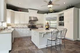 image of white kitchen cabinets with grey countertops