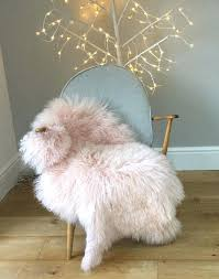 pink sheepskin rug throw gorgeous pale chair cover bed carpet by faux mongolian fur