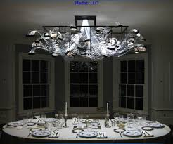 this totally unique chandelier was designed and produced by madlab llc out of montclair new jersey they used one s150 w illuminator 300 feet of the