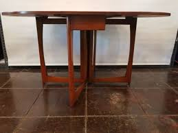 mid century danish modern drop leaf dining table from england with crown cut southeast asian