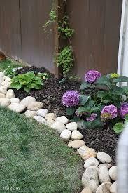river rock planter border ella claire