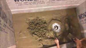 installing a mortar shower pan with schluter kerdi drain