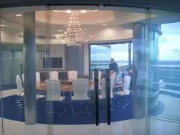 an image of curved doors made out of switchable glass