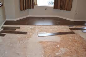 installing laminate wood floor over tile