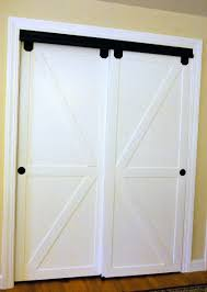 diy faux barn doors on a sliding bypass closet door 02 featured on remodelaholic edit