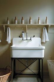 porcelain laundry sink. Modren Sink Even A Laundry Room Can Be Suitable Place For Artful Displays Such As  These Antique Beer Bottles Arrayed Above Commodious Sink In Michelle And John  For Porcelain Laundry Sink S