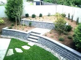 installing retaining wall blocks garden block how to build a concrete ideas walls cinder uk