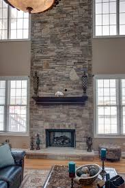 if you have ceilings that are exceptionally high you might want to add some field stone pieces that break up the fireplace and draw the eye upward