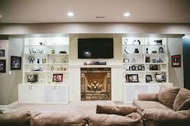 tv over fireplace in basement