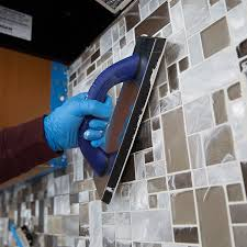 applying grout diagonally across tile backsplash
