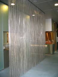 a luxury metal curtain as a room divider at a companies restaurant material