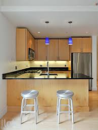 over the counter lighting. Undercabinet Lighting And Cobolt Blue Over-the-counter Accent Pendants Create A Kitchen Workspace As Beautiful It Is Functional. Over The Counter U