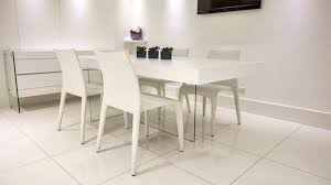 white dining table with glass leern dining chairs