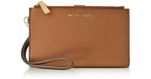 michael kors adele acorn pebble leather smartphone wristlet in brown lyst