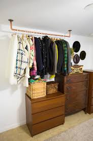 Copper garment rack Hanging Copper Pipe Clothing Rack DIY (click through  for tutorial)