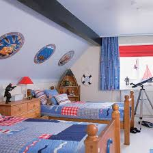 Boys' bedroom with nautical theme and boat-shaped shelving