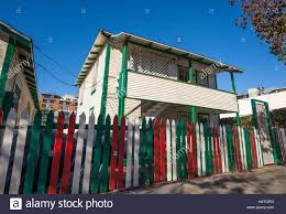 Painted Fences houses with wooden fences painted in the colors of the italian 4615 by xevi.us