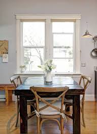 rustic table and chairs mixing wood tones remodelaholic