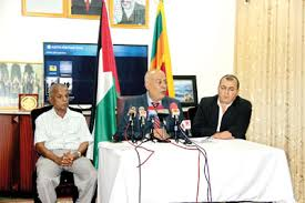 balfour years on essay competition on palestinian s quest ambassador zuhair mohammad hamdallah zaid flanked by his deputy hesham abu taha right and solidarity movement member mahinda hattaka during