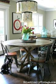 farmhouse round table love this round farmhouse dining table and industrial chairs farmhouse table plans diy farmhouse round table