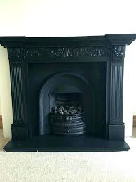 cast iron electric fireplace stone mantel with and antique surround creates a vintage insert