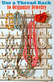use a spool thread rack for the craft to organize jewelry hip2save