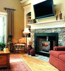 tv above mantel above fireplace ideas stone with mantle over tv mount fireplace mantel