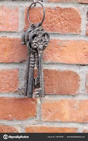 old key to hang on brick wall stock photo
