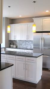 kitchen countertops white cabinets. Small Minimalist Design White Cupboard Kitchen With Modern Backsplash Also Large Refrigerator Black Countertops Cabinets N