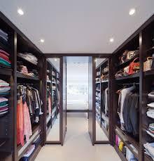 walk through closet closet contemporary with tall mirrors gray storage cabinets