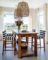 in the kitchen of this buenos aires home graphic striped fabric on the chairs balance the diy home decorhome furnituretall dining room