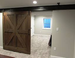 great use of rolling barn doors on existing steel beam in this bat remodel in ijamsville md