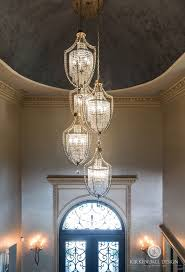 furniture glamorous chandelier for entrance foyer 18 remarkable lighting high ceilings door white wall garnish chandeliers
