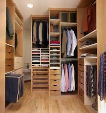 goldenrod laminate floor mixed with wooden closet designs in hanging clothes areas and shelves also corner