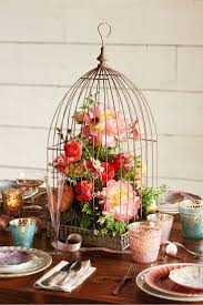 Creative centerpiece using a birdcage! http://rstyle.me/n/