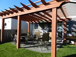 paver patio with pergola. Pergola Set Over Paver Patio. This Cedar Defines The Outdoor Entertaining Area Of Patio With W