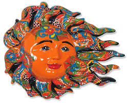 on talavera ceramic wall art with large talavera sun face with wind blown flames