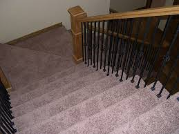 carpet on stairs. slicing carpet around pickets is not a desireable installation on stairs