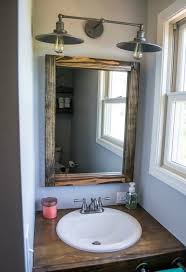 lighting fixtures for bathroom vanity. bathroom vanity with diy scrap wood mirror and rustic light fixture lighting fixtures for