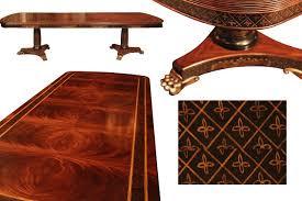 inlaid gany dining table with br lion paw feet ebony gold accents