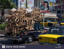 Pickup truck filled with wood furniture in Alexandria Egypt Stock