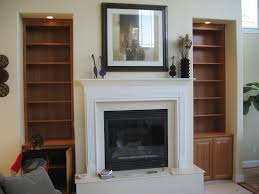 living room interior living room white cement fireplace built in shelves also brown wooden bookshelves surrounding on white painted wall panel with shelf