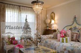 decorations girls bedroom in the cottage style wallpaper on the ceiling and walls crystal chandelier wrapped gifts pink and white